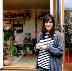 Chloe Harrison outside her garden workshop