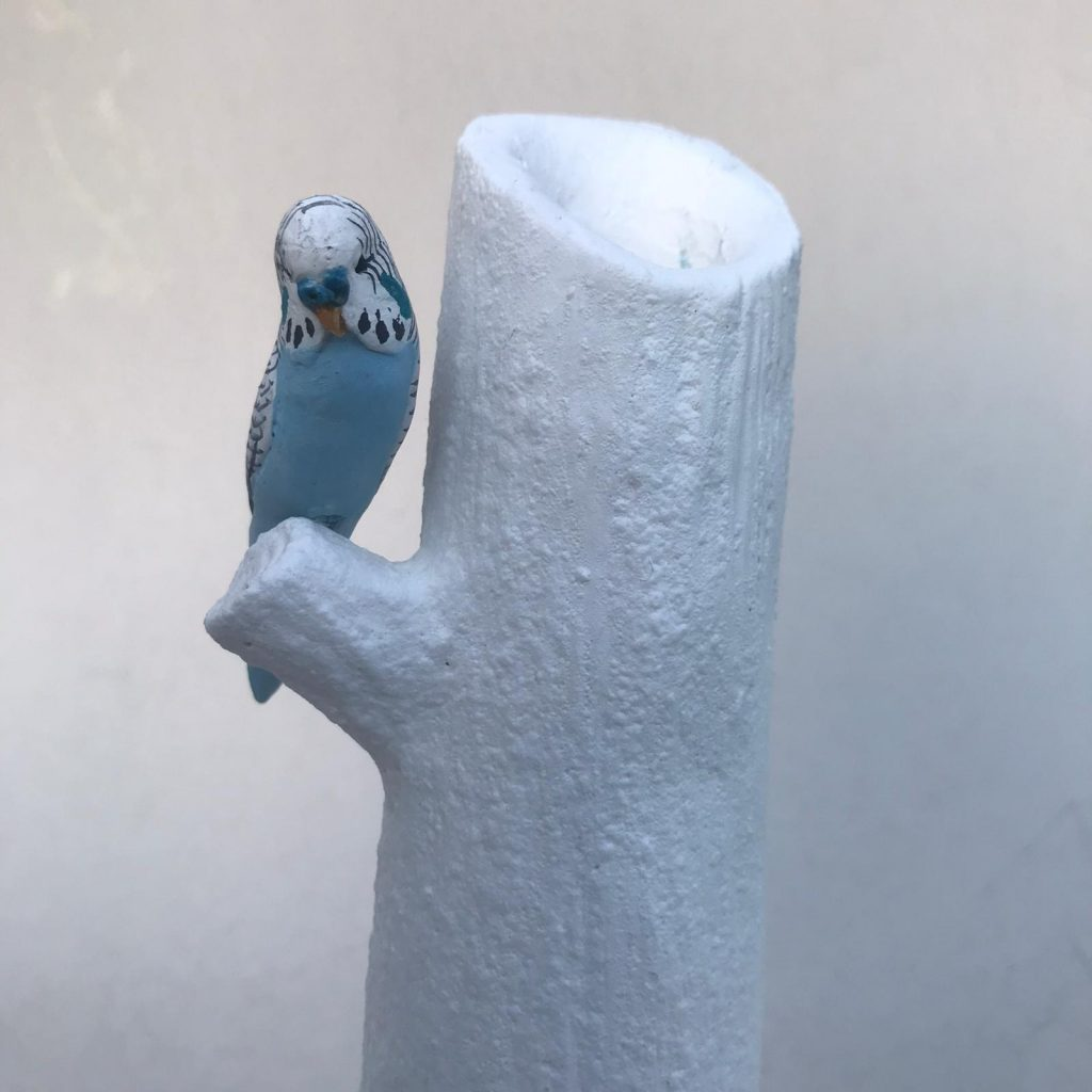 Candle holder with budgie